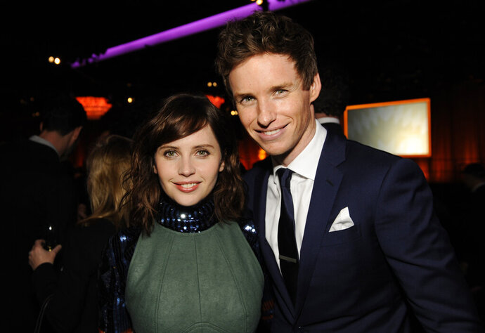 "FILE - This Feb. 2, 2015 file photo shows Felicity Jones, left, and Eddie Redmayne at the 87th Academy Awards nominees luncheon in Beverly Hills, Calif. Jones and Redmayne, who starred in ""Theory of Everything,"" reunite for their latest film"