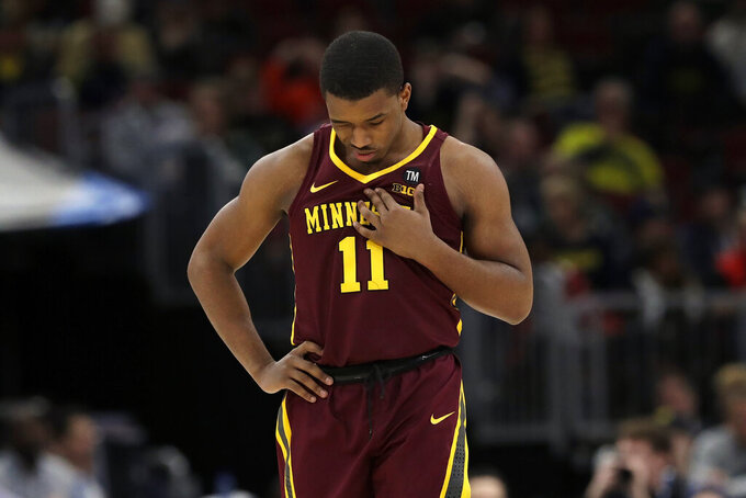Minnesota's Isaiah Washington (11) looks down during the second half of an NCAA college basketball game against Michigan in the semifinals of the Big Ten Conference tournament, Saturday, March 16, 2019, in Chicago. Michigan won 76-49.(AP Photo/Nam Y. Huh)