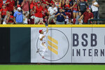 Cincinnati Reds' Shogo Akiyama makes a leaping catch at the outfield wall during the seventh inning of the team's baseball game against the St. Louis Cardinals in Cincinnati, Saturday, July 24, 2021. (AP Photo/Aaron Doster)
