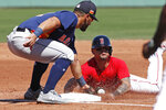 Houston Astros third baseman Abraham Toro tags Boston Red Sox's Michael Chavis who is out trying to steal third during a spring training baseball game, Thursday, March 5, 2020, in Fort Myers, Fla. (AP Photo/Elise Amendola)