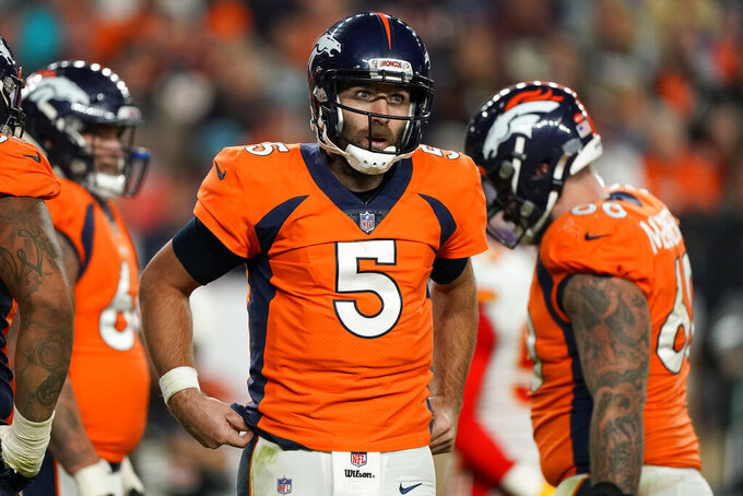 Denver Broncos quarterback Joe Flacco (5) looks to his bench after being sacked against the Kansas City Chiefs during the second half of an NFL football game, Thursday, Oct. 17, 2019, in Denver. (AP Photo/Jack Dempsey)
