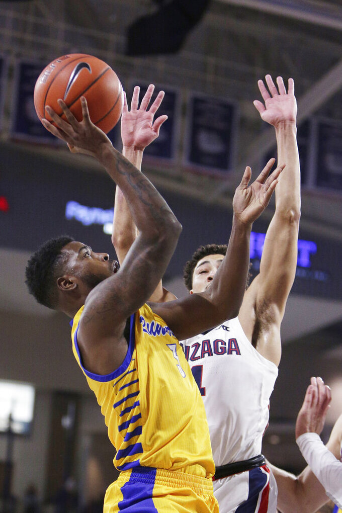 Cal State Bakersfield guard Cam Allen, left, shoots over Gonzaga guard Ryan Woolridge during the first half of an NCAA college basketball game in Spokane, Wash., Saturday, Nov. 23, 2019. (AP Photo/Young Kwak)