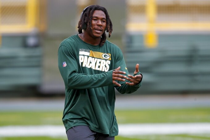 Green Bay Packers' Jamaal Williams dances to some music before an NFL football game against the Detroit Lions Sunday, Sept. 20, 2020, in Green Bay, Wis. (AP Photo/Matt Ludtke)