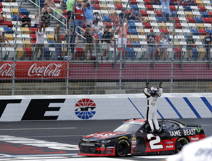 Tyler Reddick celebrates after winning the NASCAR Xfinity Series auto race at Charlotte Motor Speedway in Concord, N.C., Saturday, May 25, 2019. (AP Photo/Chuck Burton)