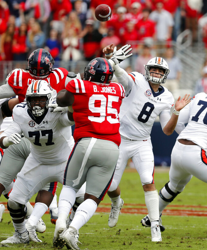 Auburn quarterback Jarrett Stidham (8) passes over Mississippi defensive tackle Benito Jones (95) during the first half of an NCAA college football game on Saturday, Oct. 20, 2018, in Oxford, Miss. Auburn won 31-16. (AP Photo/Rogelio V. Solis)