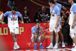 Nicolas Laprovittola of Argentina, second from left, reacts after their loss to Spain in their first-place match in the FIBA Basketball World Cup at the Cadillac Arena in Beijing, Sunday, Sept. 15, 2019. (AP Photo/Mark Schiefelbein)