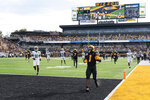 Missouri running back Tyler Badie (1) scores a touchdown during the second quarter of an NCAA college football game against North Texas, Saturday, Oct. 9, 2021, in Columbia, Mo. (AP Photo/L.G. Patterson)