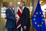 UK Brexit secretary Stephen Barclay, right, is welcomed by European Union chief Brexit negotiator Michel Barnier before their meeting at the European Commission headquarters in Brussels, Friday, Oct. 11, 2019. (AP Photo/Francisco Seco, Pool)