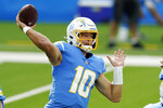 FILE - In this Sunday, Nov. 22, 2020, file photo, Los Angeles Chargers quarterback Justin Herbert throws a pass against the New York Jets during the first half of an NFL football game in Inglewood, Calif. Buffalo's Josh Allen and the AFC East-leading Bills prepare to host the rookie Justin Herbert-led Chargers on Sunday in a showdown of the NFL's two leaders in yards passing.  (AP Photo/Jae C. Hong, File)