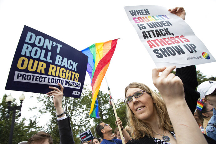 Transgender woman Alison Gill from Maryland, joins LGBT supporters in front of the U.S. Supreme Court, Tuesday, Oct. 8, 2019, in Washington. The Supreme Court is set to hear arguments in its first cases on LGBT rights since the retirement of Justice Anthony Kennedy. Kennedy was a voice for gay rights while his successor, Brett Kavanaugh, is regarded as more conservative. Amid their annual vigils for transgender homicide victims, trans-rights activists in the U.S. are trying to maintain long-term optimism even as many hard-won protections are under threat. (AP Photo/Manuel Balce Ceneta)