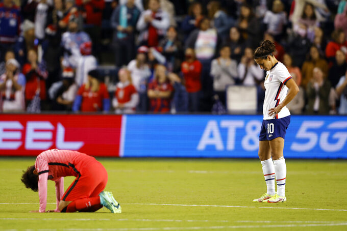 South Korea's Yeo Minji, left, and United States' Carli Lloyd, right, react at the conclusion of an international friendly soccer match in Kansas City, Kan., Thursday, Oct. 21, 2021. The match ended with no score. (AP Photo/Colin E. Braley)