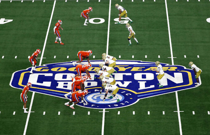 Clemson, left, lines up against Notre Dame, right, in the first half of the NCAA Cotton Bowl semi-final playoff football game, Saturday, Dec. 29, 2018, in Arlington, Texas. (AP Photo/Roger Steinman)