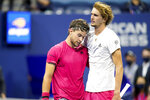 Dominic Thiem, of Austria, left, and Alexander Zverev, of Germany, embrace after the men's singles final of the US Open tennis championships, Sunday, Sept. 13, 2020, in New York. (AP Photo/Frank Franklin II)