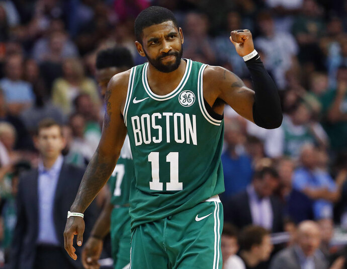 Boston Celtics guard Kyrie Irving celebrates a basket during the second half of the team's NBA basketball game against the Phoenix Suns, Thursday, Nov. 8, 2018, in Phoenix. The Celtics won 116-109 in overtime. (AP Photo/Matt York)