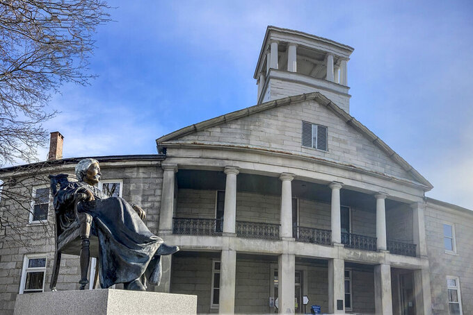 In this Tuesday, January 19, 2021, photo the Melville Fuller statue is displayed in front of the old Kennebec County courthouse in Augusta, Maine. The donor of the statue of the chief justice who served when the U.S. Supreme Court legalized racial segregation in 1896 might be willing to take it back. Stephen Smith, an attorney representing Robert Fuller Jr., suggested Thursday, April 8, 2021, his client is willing to take back his 2013 gift and figure out a new location, the Kennebec Journal reported. (Joe Phelan/The Kennebec Journal via AP)