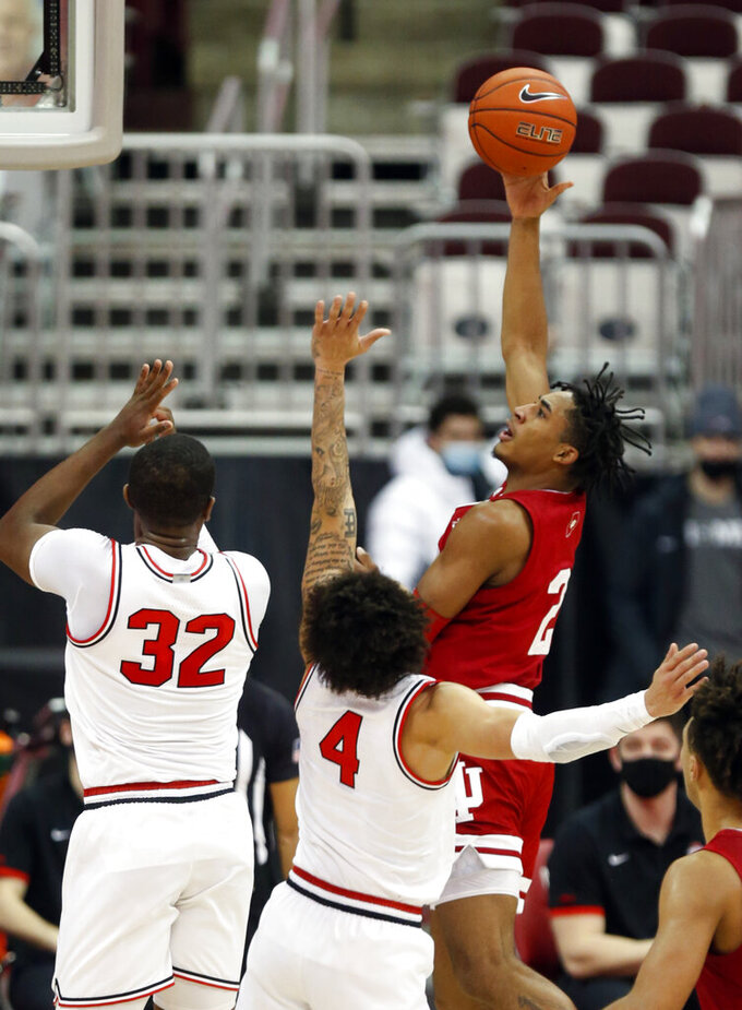 Indiana guard Armaan Franklin, left, goes up for a shot against Ohio State forward E.J. Liddell, left, and guard Duane Washington during the first half of an NCAA college basketball game in Columbus, Ohio, Saturday, Feb. 13, 2021. (AP Photo/Paul Vernon)