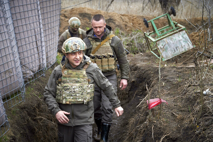 FILE - In this Friday, April 9, 2021 file photo, Ukrainian President Volodymyr Zelenskyy visits the war-hit Donbas region, eastern Ukraine. Zelenskyy has requested to speak to Russian President Vladimir Putin about the troop buildup in the Russian-Ukrainian border and the rising tensions in eastern Ukraine. (Ukrainian Presidential Press Office via AP, File)