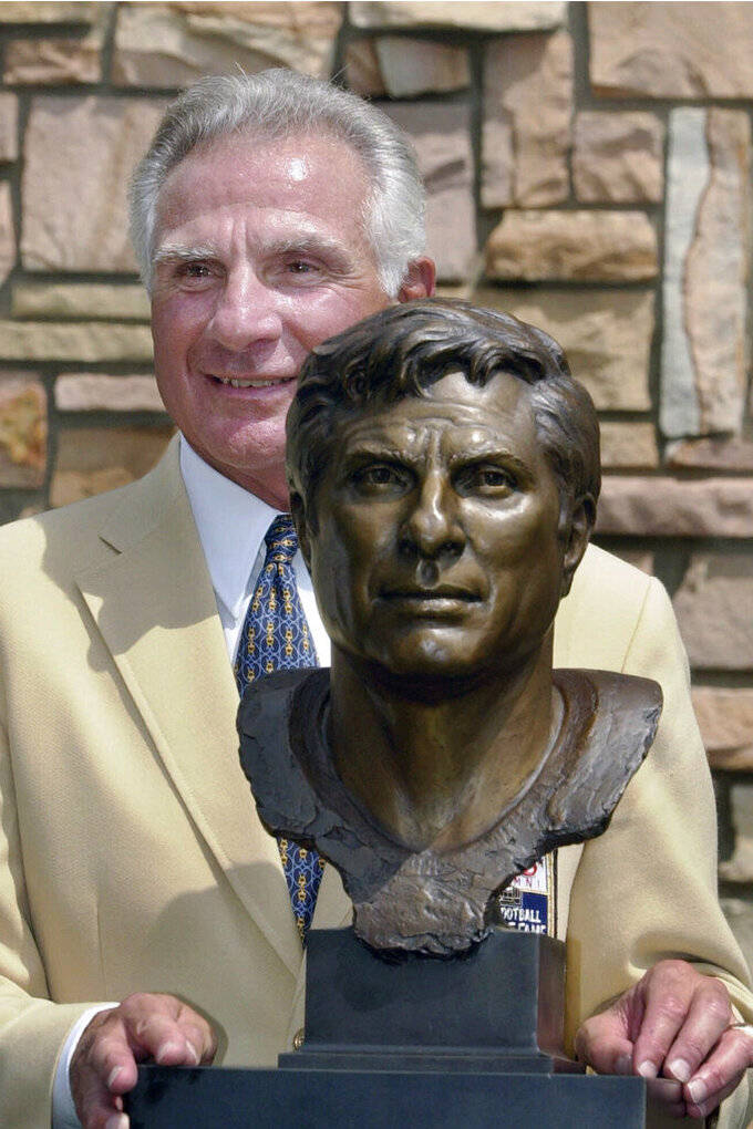 FILE - In this Aug. 4, 2001, file photo, former Miami Dolphins great Nick Buoniconti holds his bronze bust after enshrinement into the Pro Football Hall of Fame in Canton, Ohio. Nick Buoniconti, an undersized overachiever who helped lead the Miami Dolphins to the NFL's only perfect season, has died at the age of 78. Bruce Bobbins, a spokesman for the Buoniconti family, said he died Tuesday, July 30, 2019, in Bridgehampton, N.Y.  (AP Photo/Mark Duncan)
