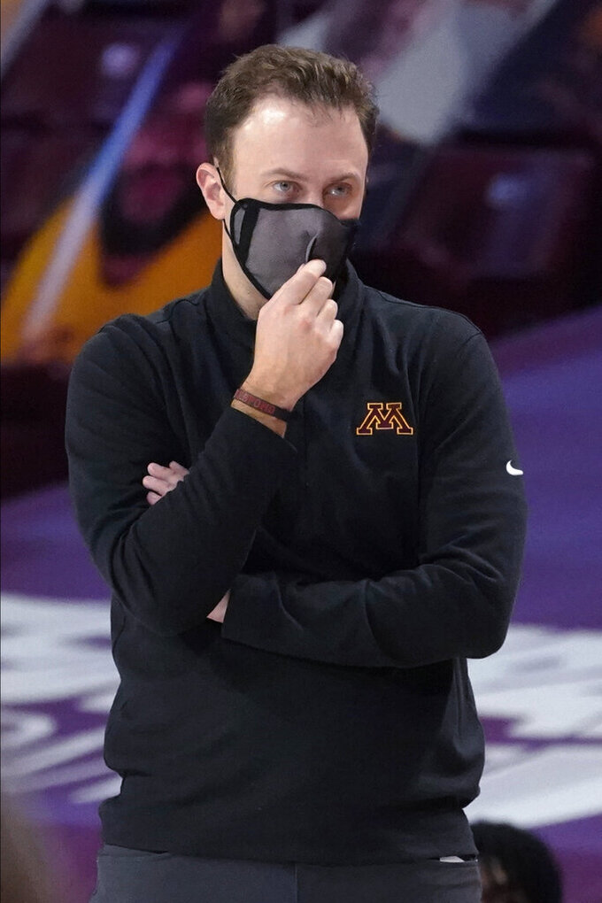 Minnesota coach Richard Pitino watches his team during the second half of an NCAA college basketball game against Illinois, Saturday, Feb. 20, 2021, in Minneapolis. Illinois won 94-63. (AP Photo/Jim Mone)