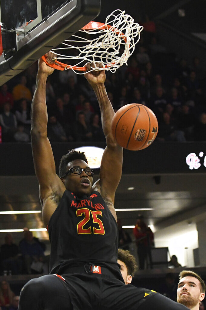 Maryland forward Jalen Smith (25) dunks the ball against Northwestern during the first half of an NCAA college basketball game, Tuesday, Jan. 21, 2020, in Evanston, Ill. (AP Photo/David Banks)