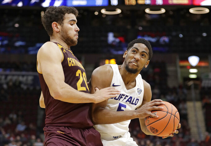 Buffalo's CJ Massinburg (5) drives past Central Michigan's Kevin McKay (20) during the second half of an NCAA college basketball game in the semifinals of the Mid-American Conference men's tournament Friday, March 15, 2019, in Cleveland. Buffalo won 85-81. (AP Photo/Tony Dejak)
