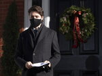 Prime Minister Justin Trudeau walk to the podium for a news conference outside of Rideau Cottage in Ottawa, Tuesday Nov. 24, 2020.  (Adrian Wyld/The Canadian Press via AP)