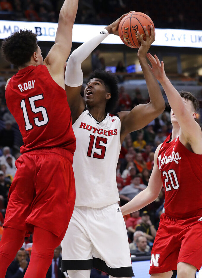 Rutgers center Myles Johnson, center, shoots against Nebraska forward Isaiah Roby, left, and forward Tanner Borchardt during the second half of an NCAA college basketball game in the first round of the Big Ten Conference tournament in Chicago, Wednesday, March 13, 2019. Nebraska won 68-61. (AP Photo/Nam Y. Huh)