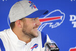 Buffalo Bills quarterback Josh Allen smiles during a news conference Friday Aug. 6, 2021, in Orchard Park, N.Y. The Bills on Friday announced Allen agreed to a six-year contract extension that locks up the fourth-year starter through the 2028 season. (AP Photo/ Jeffrey T. Barnes)