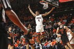 Oregon State's Alfred Hollins leaps while defending Southern California's Kevin Porter Jr. during the first half of an NCAA college basketball game in Corvallis, Ore., Thursday, Jan. 10, 2019. (AP Photo/Amanda Loman)