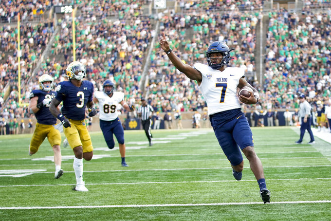 Toledo quarterback Dequan Finn (7) scores a touchdown in the second half of an NCAA college football game against Notre Dame in South Bend, Ind., Saturday, Sept. 11, 2021. Notre Dame won 32-29. (AP Photo/AJ Mast)