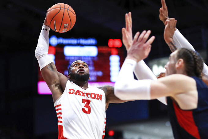 Dayton's Trey Landers (3) drives to the basket in the first half of an NCAA college basketball game against Duquesne, Saturday, Feb. 22, 2020, in Dayton, Ohio. (AP Photo/Aaron Doster)