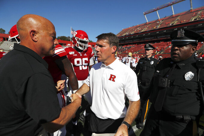 Rutgers head coach Chris Ash, center, shakes hands with head coach Steve Addazio of Boston College after an NCAA college football game on Saturday, Sept. 21, 2019, in Piscataway, N.J. Boston College won, 30-16. (Chris Faytok/NJ Advance Media via AP)