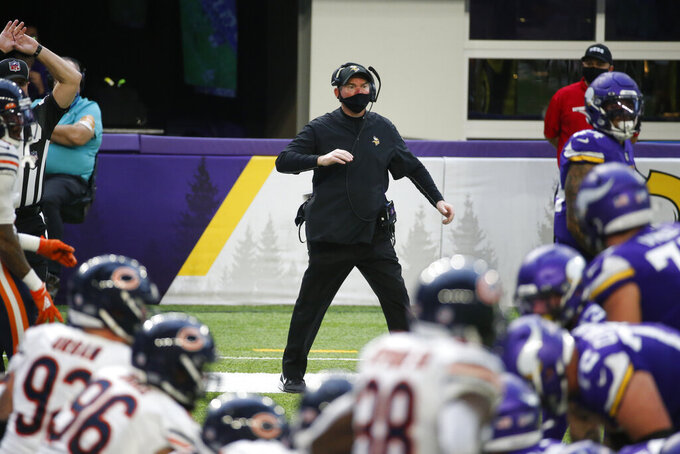 File-This Dec. 20, 2020, file photo shows Minnesota Vikings head coach Mike Zimmer reacting on the sideline during the second half of an NFL football game against the Chicago Bears, in Minneapolis.  Zimmer was discouraged by the state of his defense and the limited opportunity to improve it this offseason, but a handful of free-agent additions gave him fresh hope. (AP Photo/Bruce Kluckhohn, File)