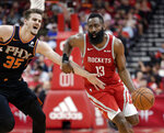 Houston Rockets guard James Harden (13) drives around Phoenix Suns forward Dragan Bender (35) during the second half of an NBA basketball game Sunday, April 7, 2019, in Houston. (AP Photo/Michael Wyke)