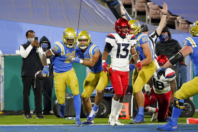 UCLA running back Brittain Brown (28) celebrates after a rushing touchdown against Arizona during the second half of an NCAA college football game Saturday, Nov. 28, 2020, in Pasadena, Calif. (AP Photo/Marcio Jose Sanchez)