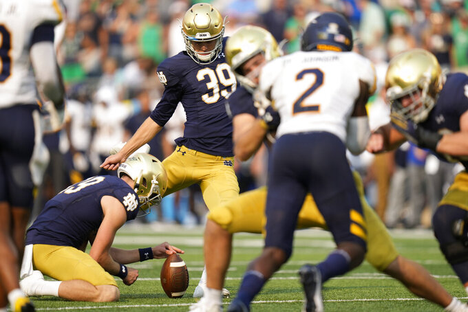 Notre Dame place kicker Jonathan Doerer (39) kicks an extra point in the second half of an NCAA college football game against Toledo in South Bend, Ind., Saturday, Sept. 11, 2021. Notre Dame won 32-29. (AP Photo/AJ Mast)