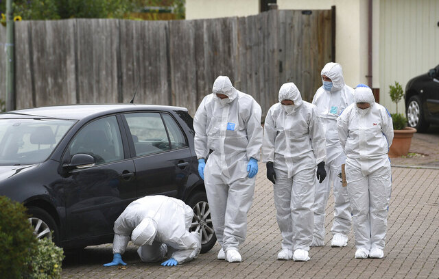 Police officers conduct a search in Kesgrave, England, Monday Sept. 7, 2020, where a 15-year-old student from Kesgrave High School was shot just after 8.40am this morning. British police said a teenager in eastern England has been arrested in connection with the shooting on Monday of a 15-year-old boy on his way to school. (Joe Giddens/PA via AP)