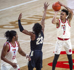 Nebraska guard Trey McGowens (2) shoots a three-point basket over Purdue's Jaden Ivey (23) as teammate Derrick Walker (13) looks on during the first half of an NCAA college basketball game on Saturday, Feb. 20, 2021, in Lincoln, Neb. (Francis Gardler/Lincoln Journal Star via AP)