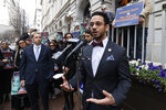 Del. Ibraheem Samirah, D-Fairfax, right, speaks during a rally outside the U.S. 4th Circuit Court of Appeals Tuesday Jan 28, 2020, in Richmond, Va.  President Donald Trump's travel ban on travelers from predominantly Muslim countries is going back before a federal appeals court.   On Tuesday, the 4th U.S. Circuit Court of Appeals in Richmond will hear arguments in three lawsuits filed by U.S. citizens and permanent residents whose relatives have been unable to enter the U.S. because of the ban.   (AP Photo/Steve Helber)
