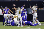 New Orleans Saints quarterback Drew Brees (9) reacts after running back Alvin Kamara scored his sixth rushing touchdown of the game, tying an NFL record, in the second half of an NFL football game against the Minnesota Vikings in New Orleans, Friday, Dec. 25, 2020. During the game, Brees also became the first NFL player to reach 80,000 yards passing. The Saints won 52-33. (AP Photo/Brett Duke)