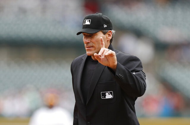 FILE - In this Sept. 1, 2019, file photo, home plate umpire Angel Hernandez signals during the fifth inning of a baseball game between the Detroit Tigers and the Minnesota Twins in Detroit. A major league official testified he suggested Hernandez be removed from consideration for the 2015 World Series because he did not think Commissioner Rob Manfred would approve the umpire to work baseball's premier event. Hernandez sued Major League Baseball in 2017, alleging race discrimination and cited his failure to be assigned to the World Series since 2005 and MLB's failure to promote him to crew chief. (AP Photo/Carlos Osorio, File)