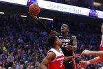 Miami Heat guard Kendrick Nunn goes to the basket against Sacramento Kings guard Yogi Ferrell during the first quarter of an NBA basketball game in Sacramento, Calif., Friday, Feb. 7, 2020. (AP Photo/Rich Pedroncelli)