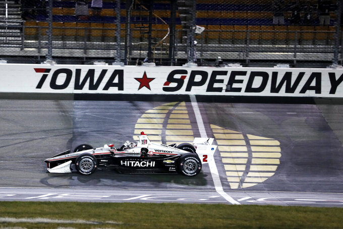 Josef Newgarden celebrates as he wins the IndyCar Series auto race Sunday, July 21, 2019, at Iowa Speedway in Newton, Iowa. (AP Photo/Charlie Neibergall)