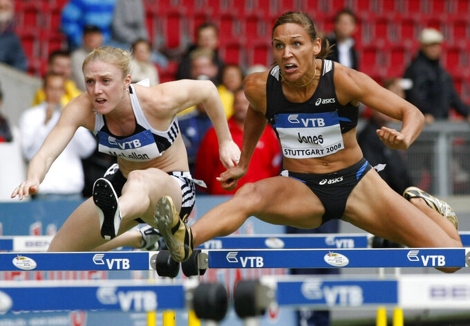 FILE - In this Saturday, Sept. 13, 2008, file photo, Lolo Jones, of the United States, right, and Sally McLellan, from Australia, clear a hurdle in the women's 100-meter hurdles race at the IAAF World Athletics Final in Stuttgart, Germany. Jones hasn't returned to China since 2008, since one bad step in what was then the biggest race of her life cost her an Olympic gold medal. Her stance might change in 2022. (AP Photo/Thomas Kienzle, File)