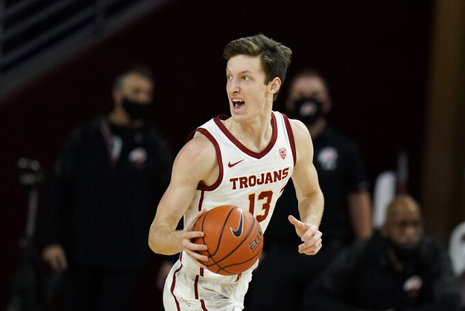 Southern California's Drew Peterson dribbles the ball during the second half of an NCAA college basketball game against Utah, Saturday, Jan. 2, 2021, in Los Angeles. USC won 64-46. (AP Photo/Jae C. Hong)