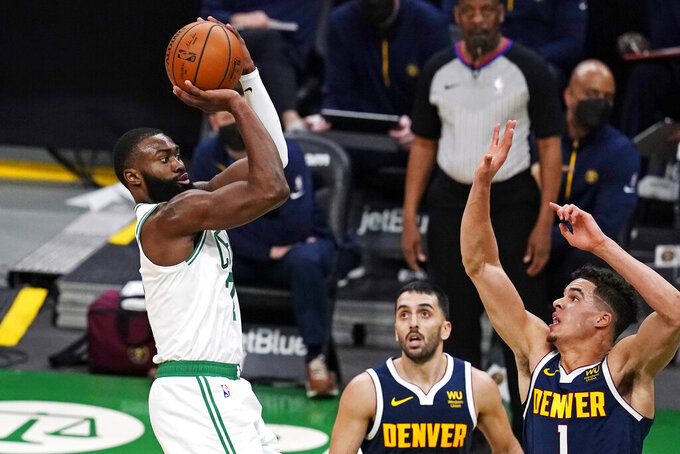 Boston Celtics guard Jaylen Brown, left, shoots over Denver Nuggets forward Michael Porter Jr. (1) and guard Facundo Campazzo, center, during the second half of an NBA basketball game, Tuesday, Feb. 16, 2021, in Boston. (AP Photo/Charles Krupa)