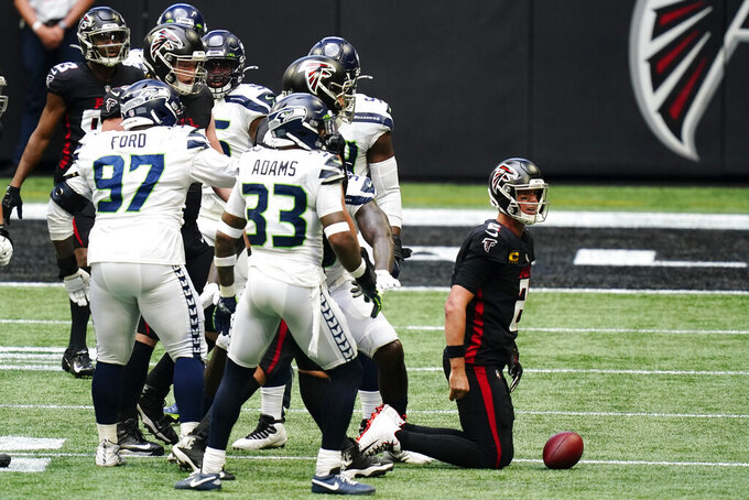 Atlanta Falcons quarterback Matt Ryan (2) gets up after being sacked by the Seattle Seahawks defense during the second half of an NFL football game, Sunday, Sept. 13, 2020, in Atlanta. (AP Photo/Brynn Anderson)
