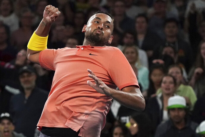 Australia's Nick Kyrgios celebrates after defeating France's Gilles Simon in their second round singles match at the Australian Open tennis championship in Melbourne, Australia, Thursday, Jan. 23, 2020. (AP Photo/Lee Jin-man)