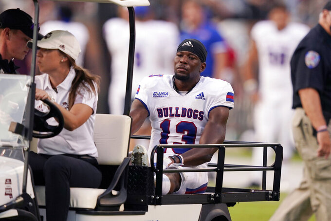 Louisiana Tech wide receiver Isaiah Graham (13) is carted off the field after getting injured catching a pass during the second half of an NCAA college football game against Mississippi State in Starkville, Miss., Saturday, Sept. 4, 2021. Mississippi State won 35-34. (AP Photo/Rogelio V. Solis)