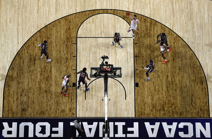 Virginia's Ty Jerome (11) takes a shot during the first half in the semifinals of the Final Four NCAA college basketball tournament against Auburn, Saturday, April 6, 2019, in Minneapolis. (AP Photo/Jeff Roberson)